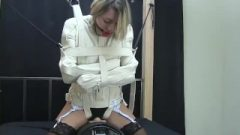 Straight Jacket Fixed To A Orgasm Machine
